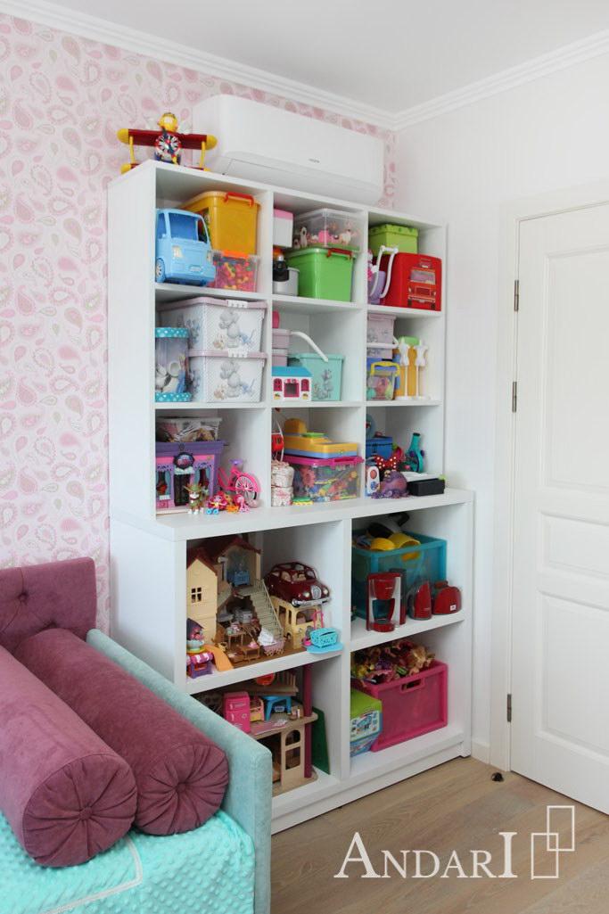 Разноуровневый шкаф-стеллаж для игрушек в детской - Андари